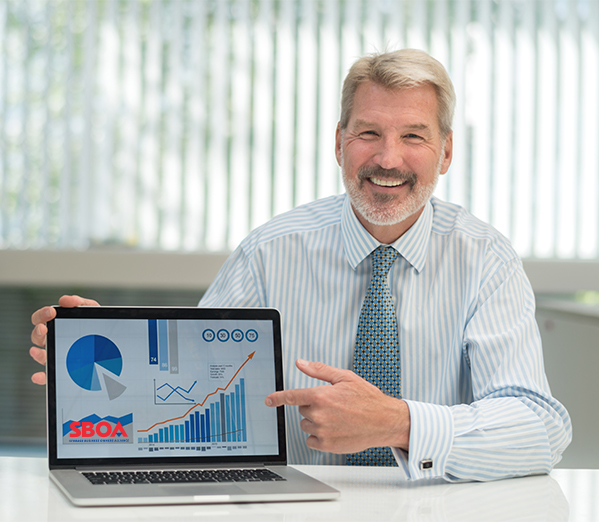 Storage business owner with laptop of charts
